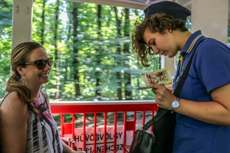 Paying the fare to a conductor on the Children's Railway in Budapest