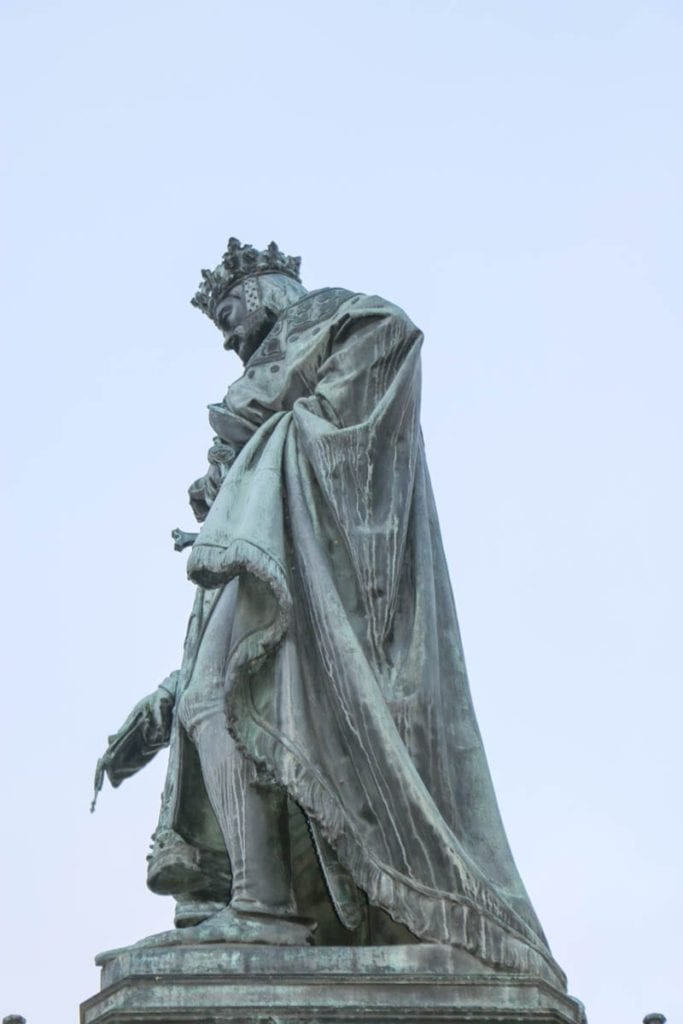 On this walking tour of Prague, you pass beneath the statute of Charles on his namesake bridge. Is King Charles peeing on the tourists?