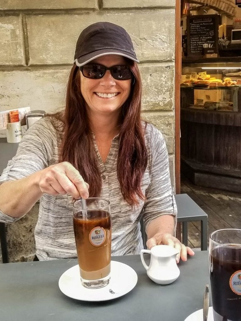 My mom with a coffee in Siena, Italy