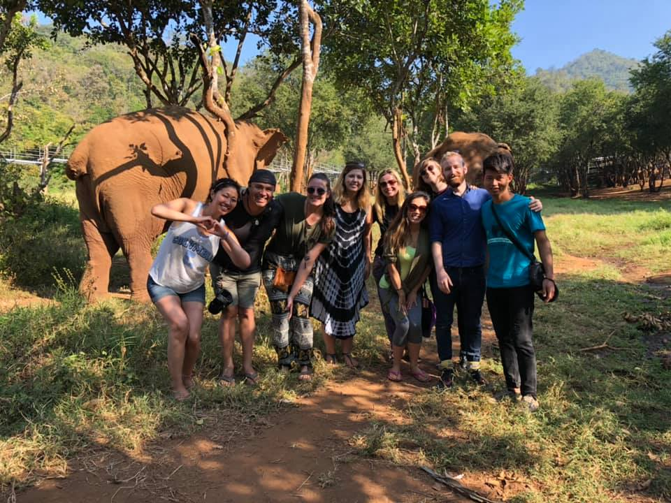 a tour group at an ethical elephant sanctuary in Thailand