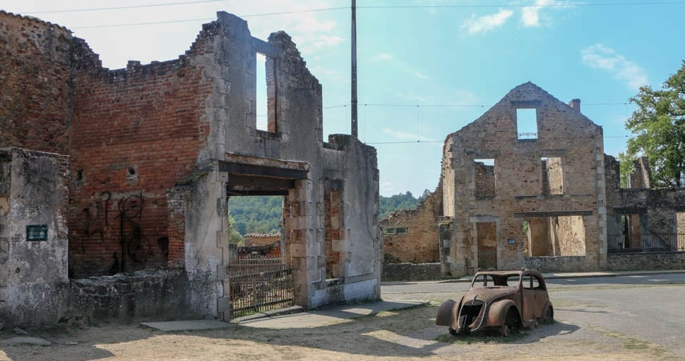 A burned out car and building in the martyr village of France, serve as a reminder of what happened at Oradour-sur-Glane