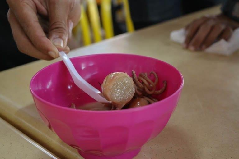Ketupat sotong is a sweet stuffed squid dessert found in Kuala Lumpur street food stands