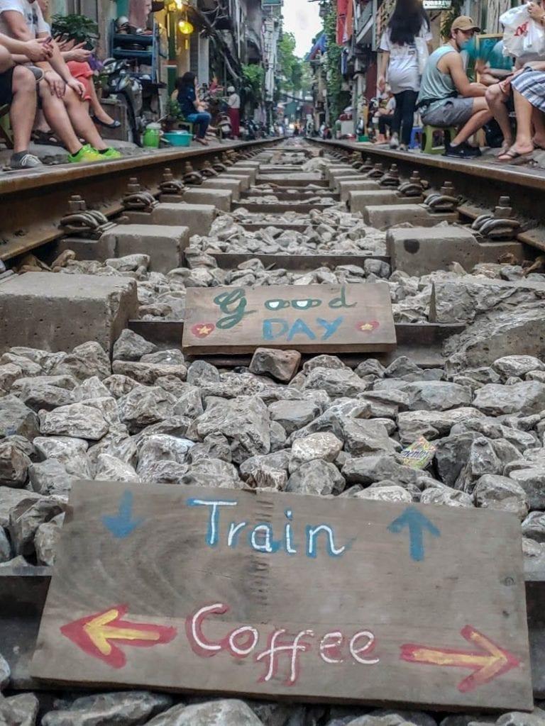 signs on the train tracks on train street in Hanoi