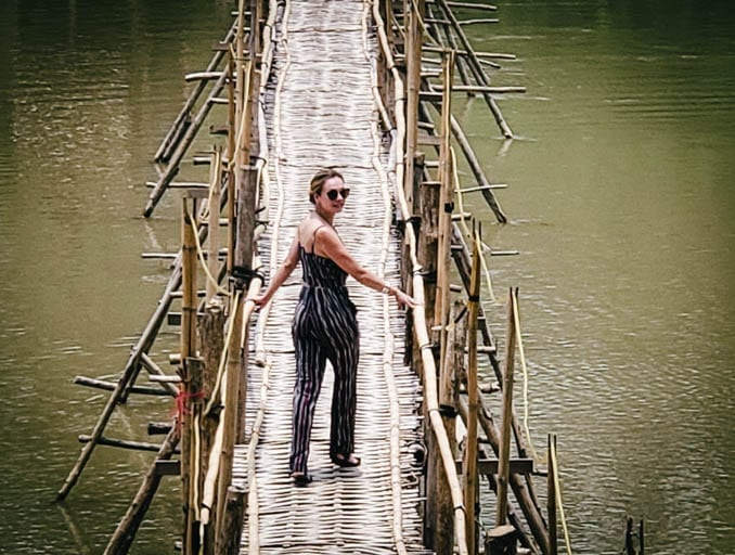 Crossing a bamboo bridge in Luang Prabang. It's the perfect place to make a wish in Southeast Asia.