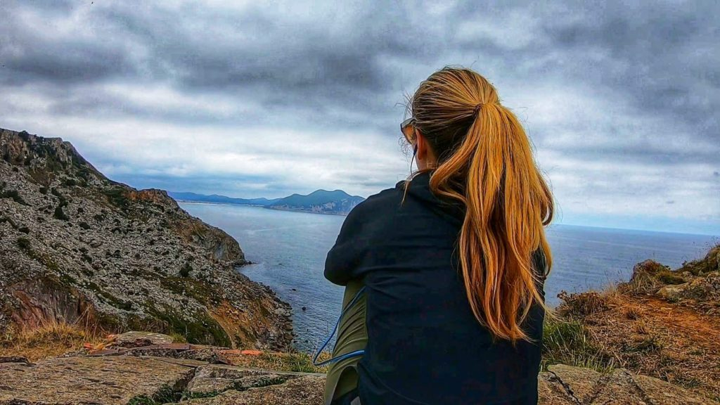 A woman gazes at the view on the camino del Norte