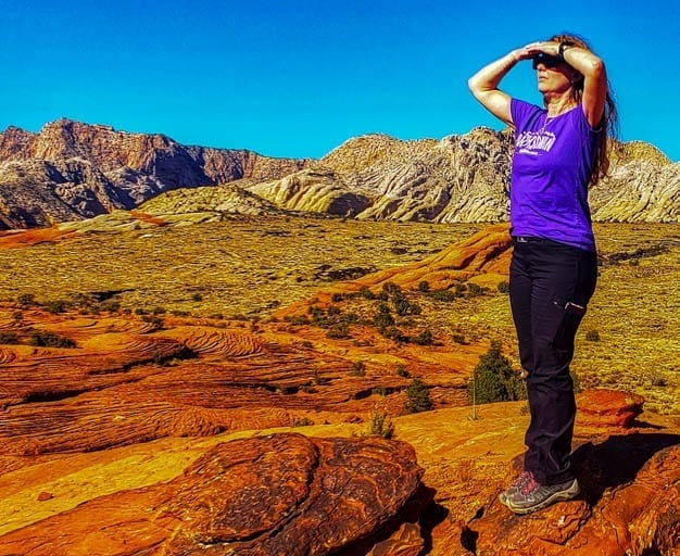 Woman gazes out at snow canyon state park