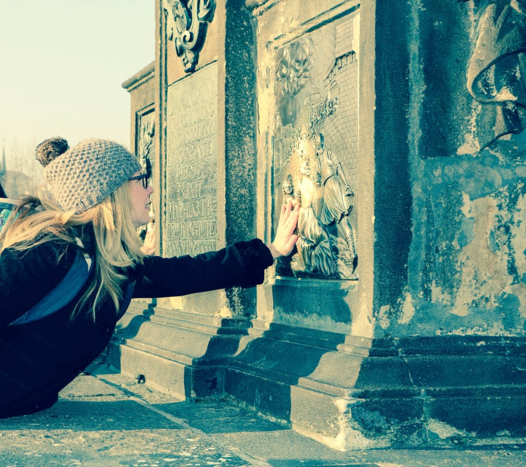 Making a wish on the Charles Bridge in Prague