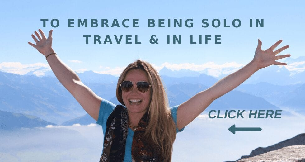 Solo Woman on a Mountaintop with triumphant arms up