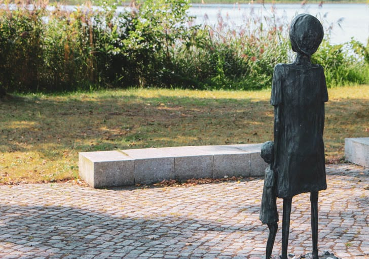 A statue of a woman with a child at the Ravensbrück Concentration Camp Memorial
