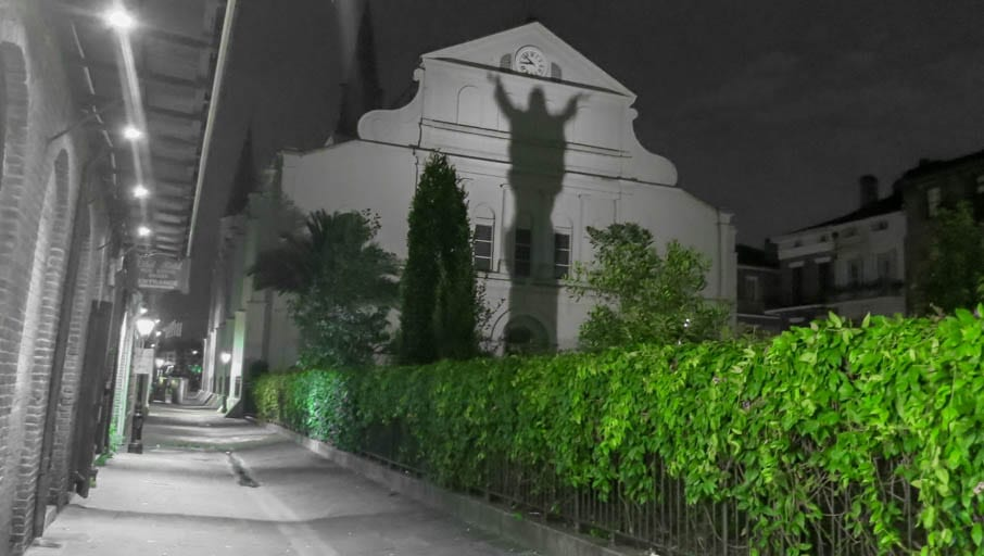 the dark history of New Orleans on display with the evening shadow of Touchdown Jesus.