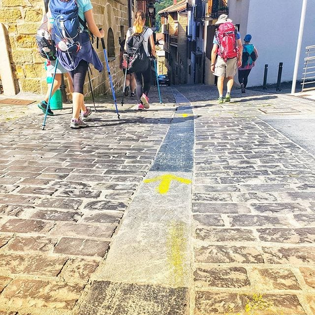 Yellow Arrow painted on the street along the Camino del Norte