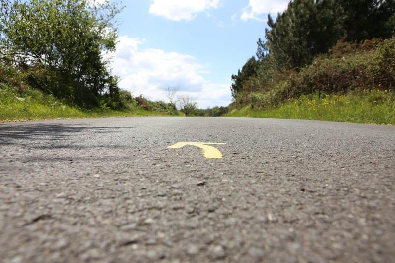 a yellow arrow on the camino de santiago