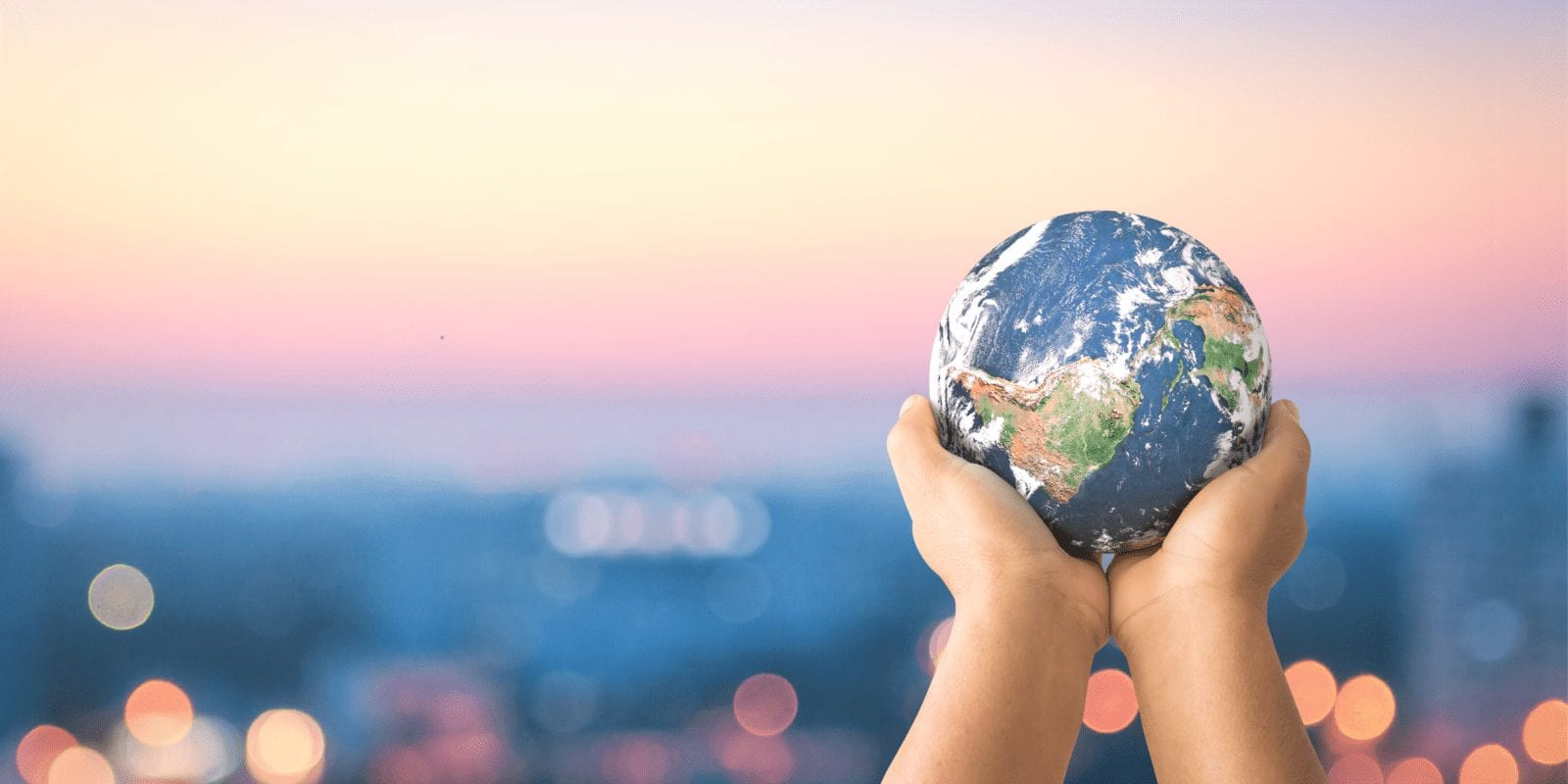 Hands holding a planet