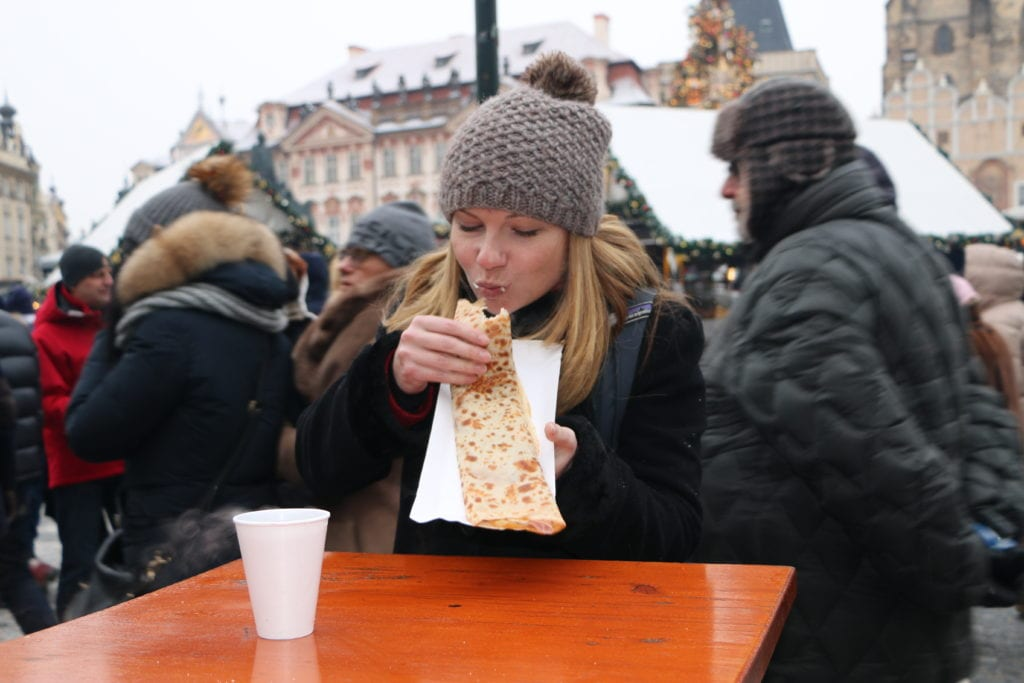 eating in a crowded outdoor market in Prague
