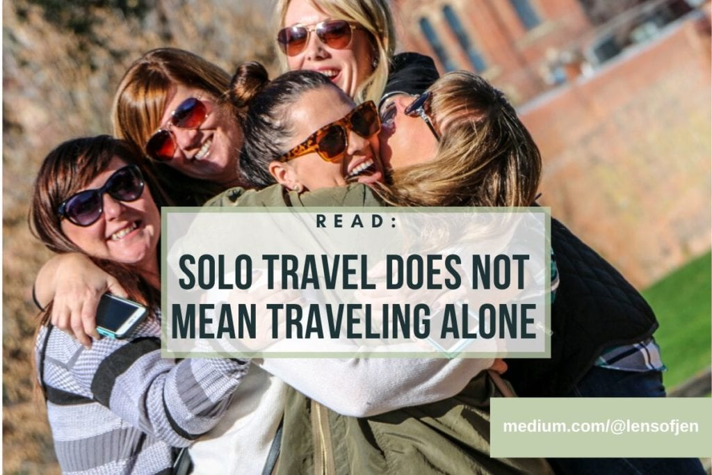 solo travel does not mean traveling alone