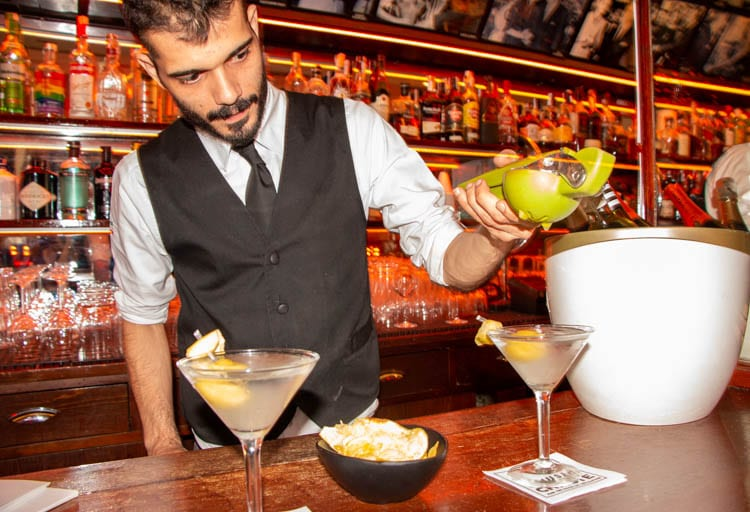 Bartender pours a drink