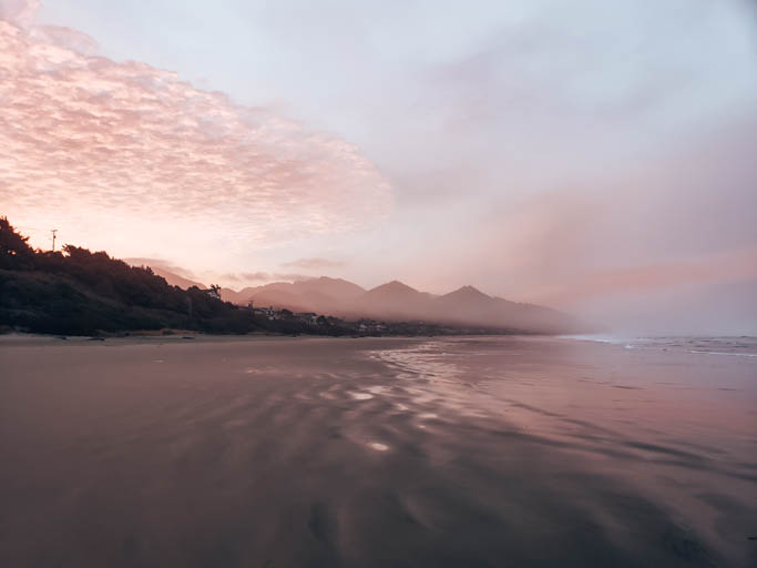 catching a sunrise at cannon beach is a key thing to do on an Oregon Coast road trip