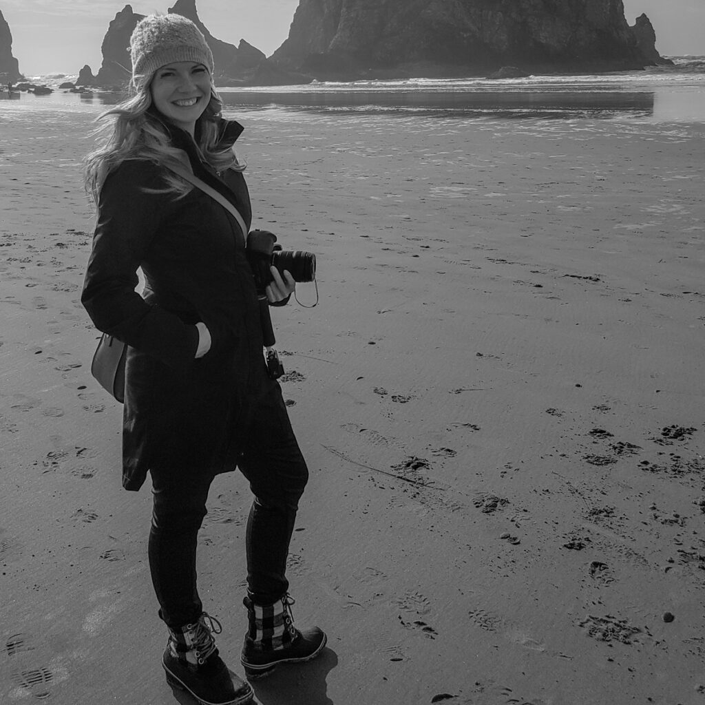 Taking photos at Haystack Rock in Cannon Beach is a must on an Oregon Coast road trip