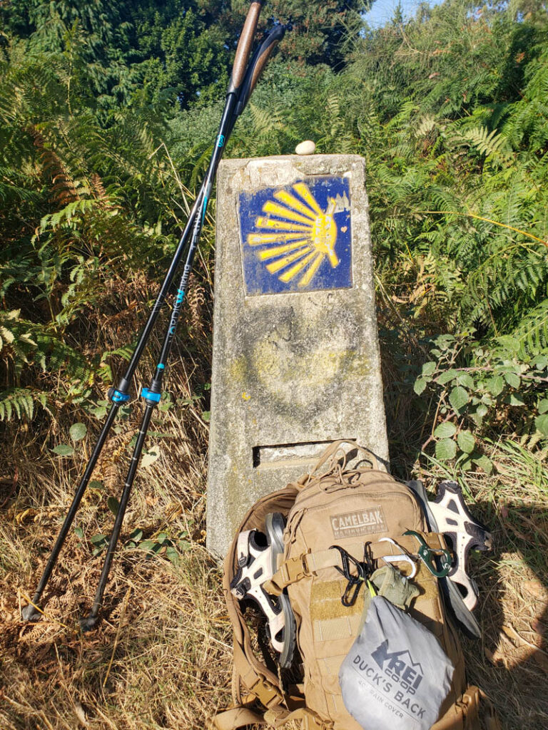 what shoes should make your camino de santiago packing list? one pair of lightweight and one pair of waterproof